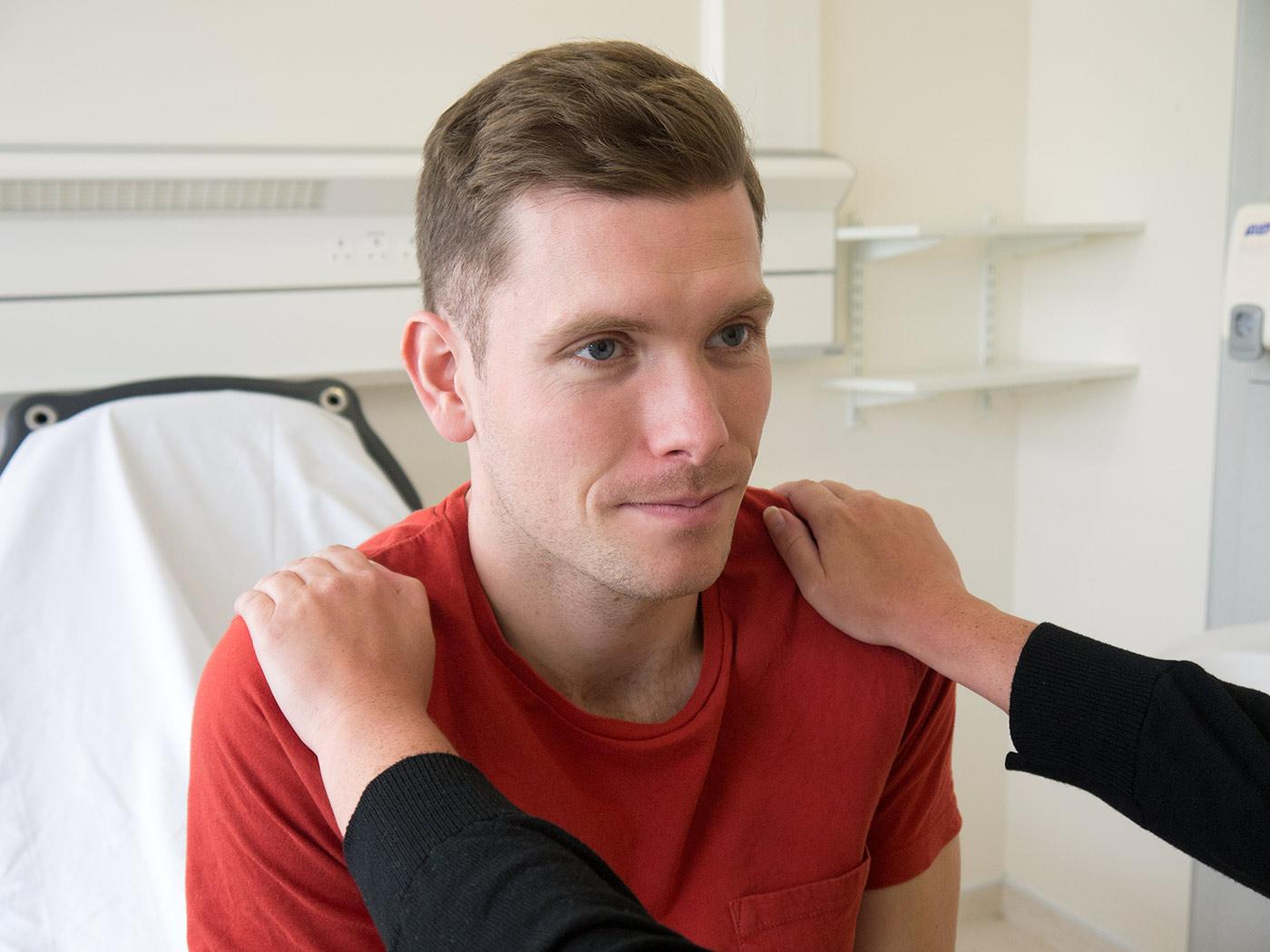 Trapezius muscle test against resistance