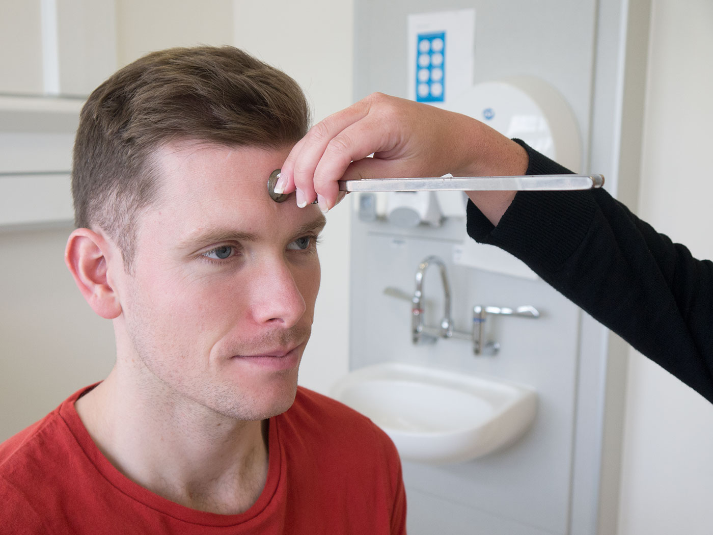 Webers test - place the tuning fork base down in the centre of the forehead