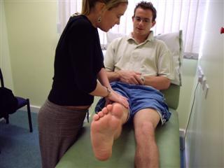 Assess hip flexion