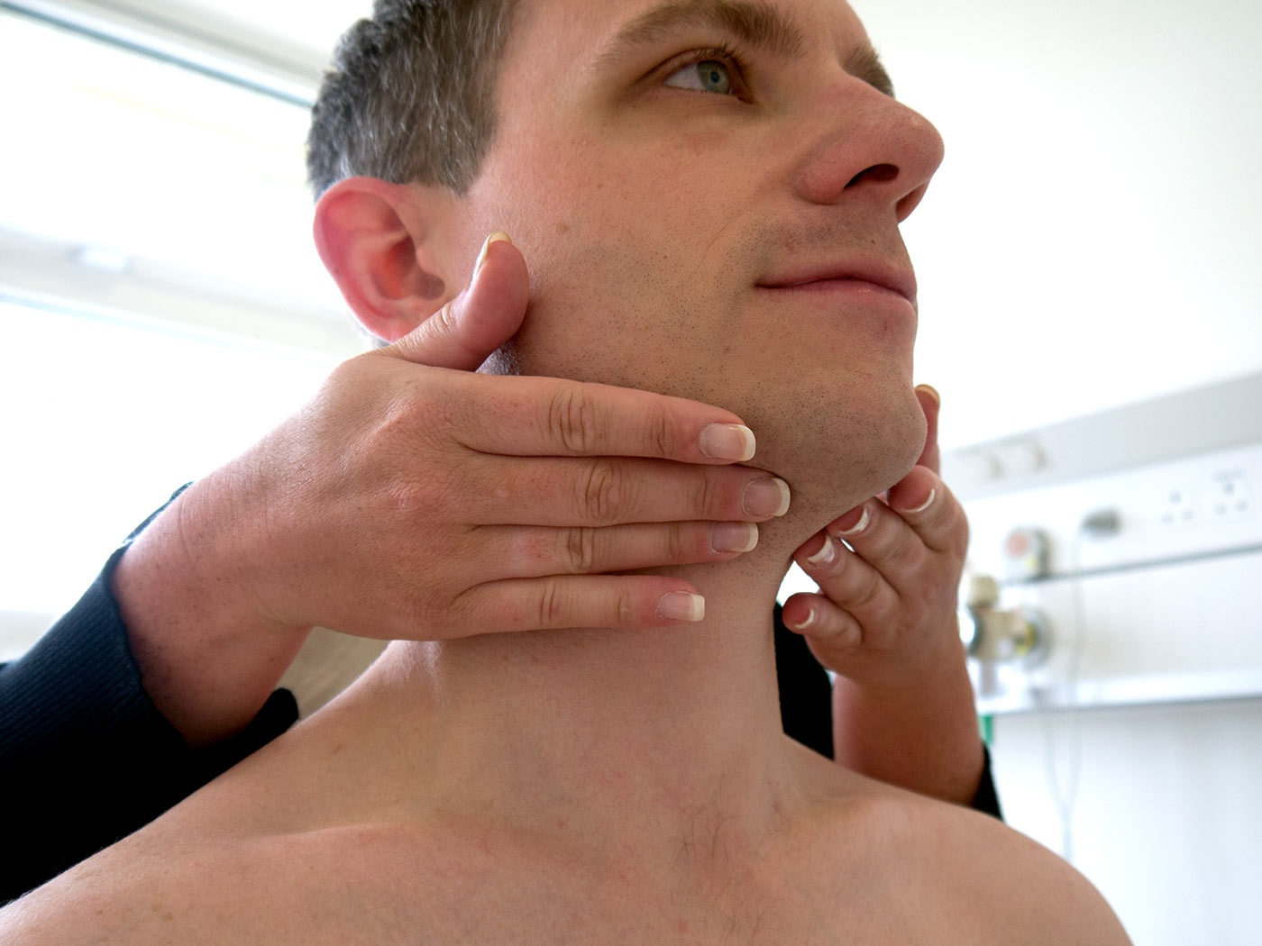 Palpate the submental lymph nodes