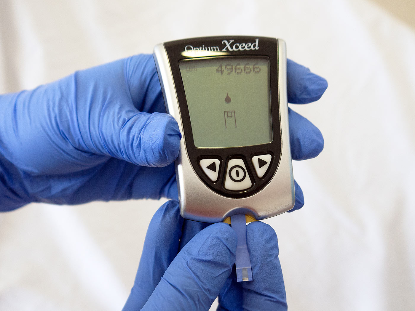 Load the test strip into the glucose monitor
