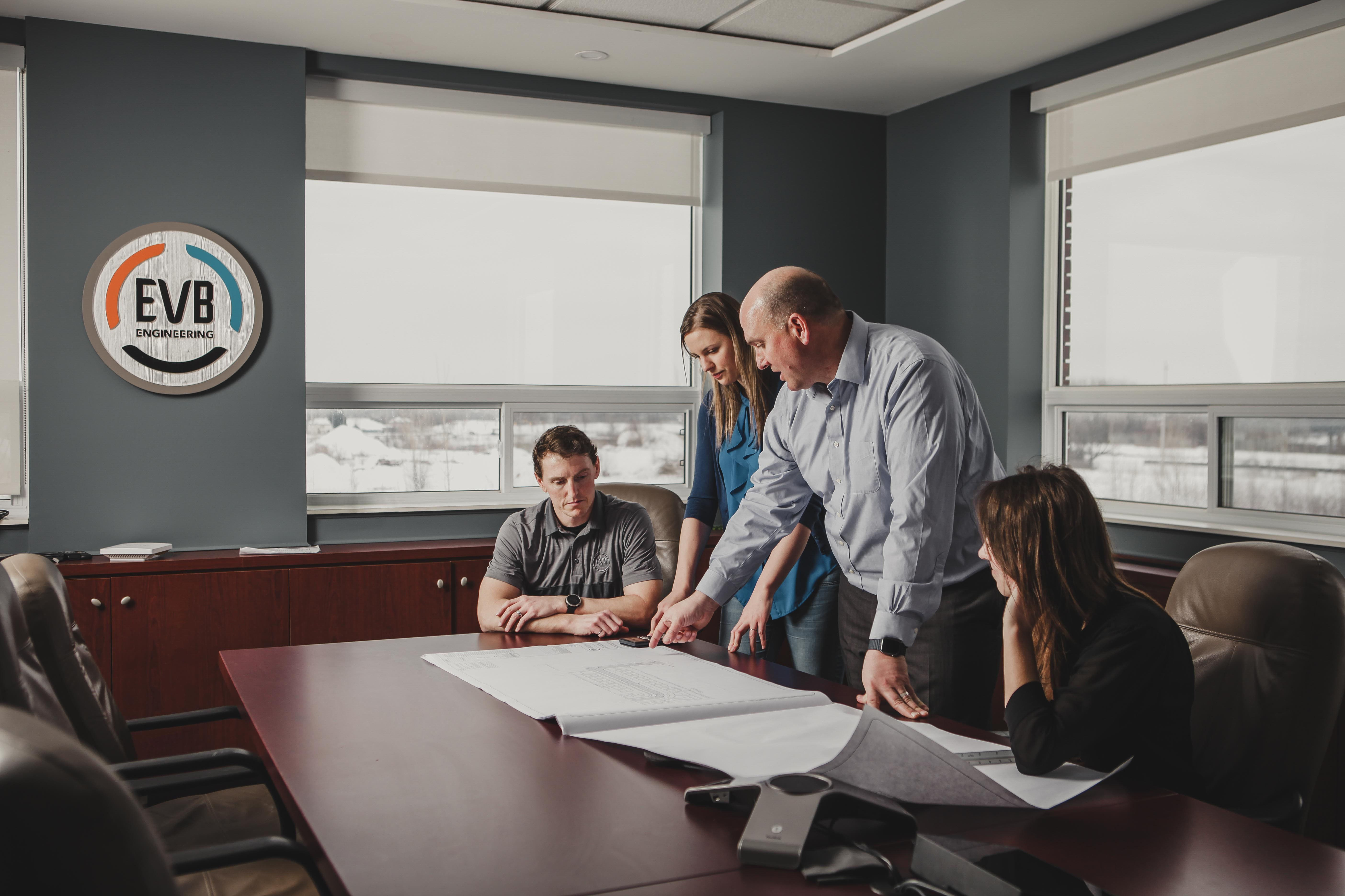 EVB Engineering team discussing a project in a board room