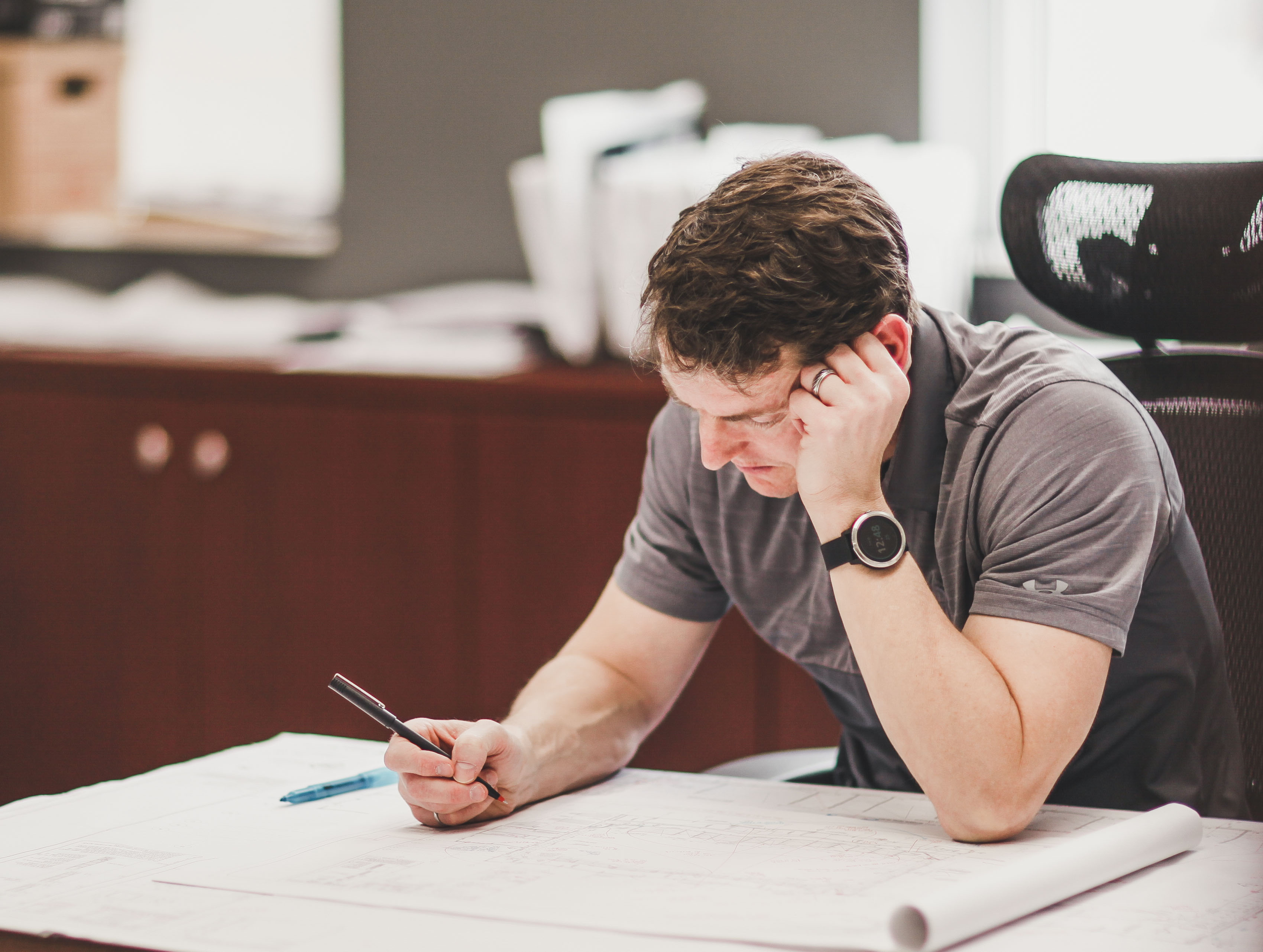 Photo of Greg Esdale working on engineering plans