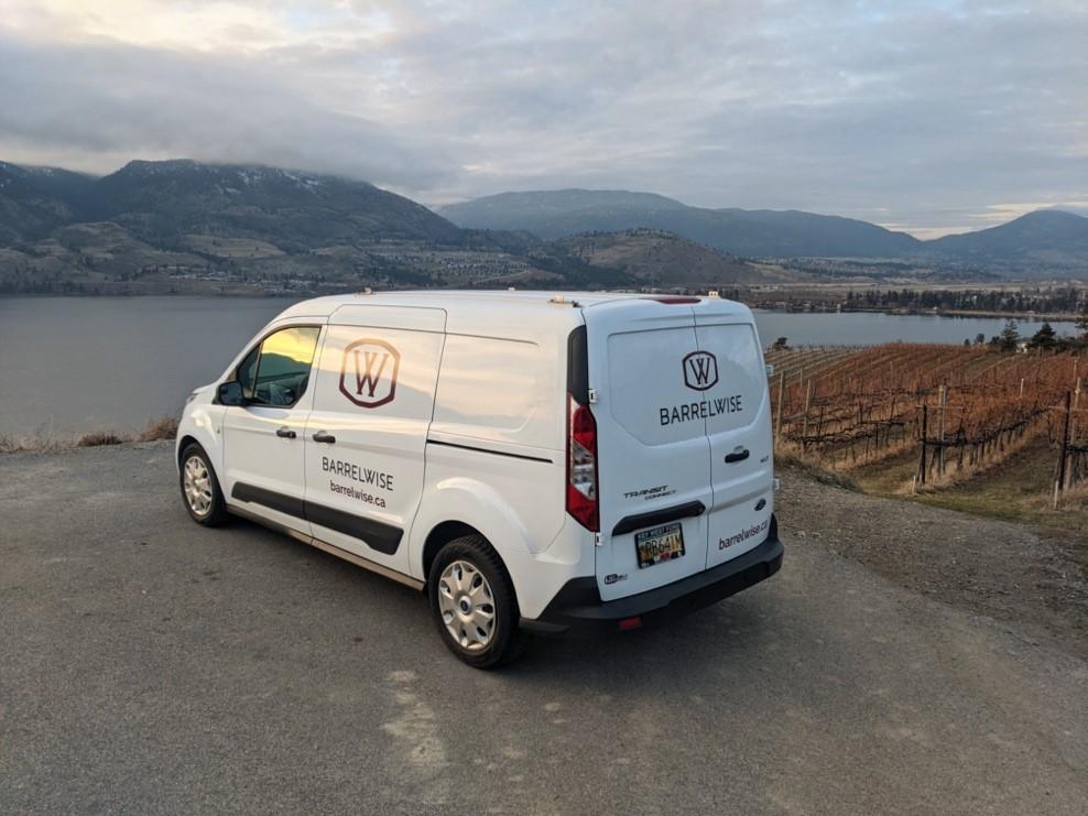BarrelWise vehicle overlooking Pentâge vineyards atop Lake Okanagan.
