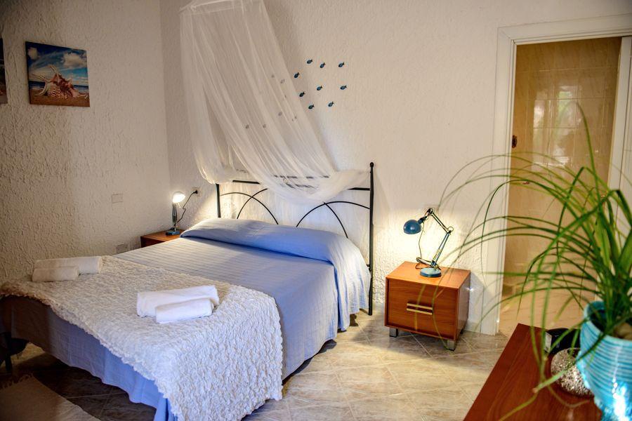 Camera da letto Villa Saline