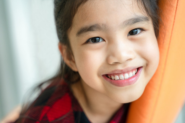 Early orthodontics treatment - young girl smiling