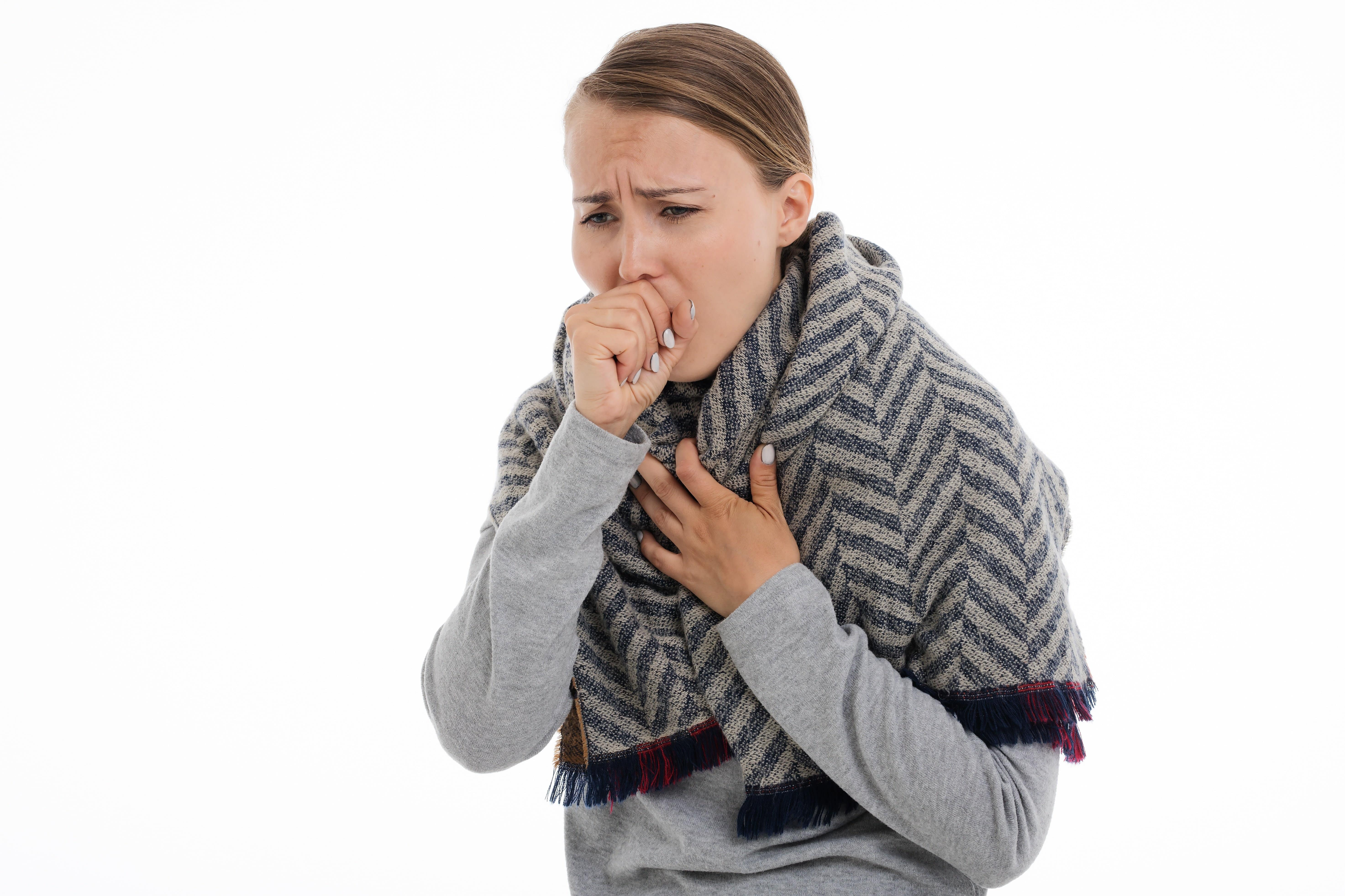 Image of woman coughing. Hyfe - Our AI appends rich metadata and context to every cough providing researchers additional insights
