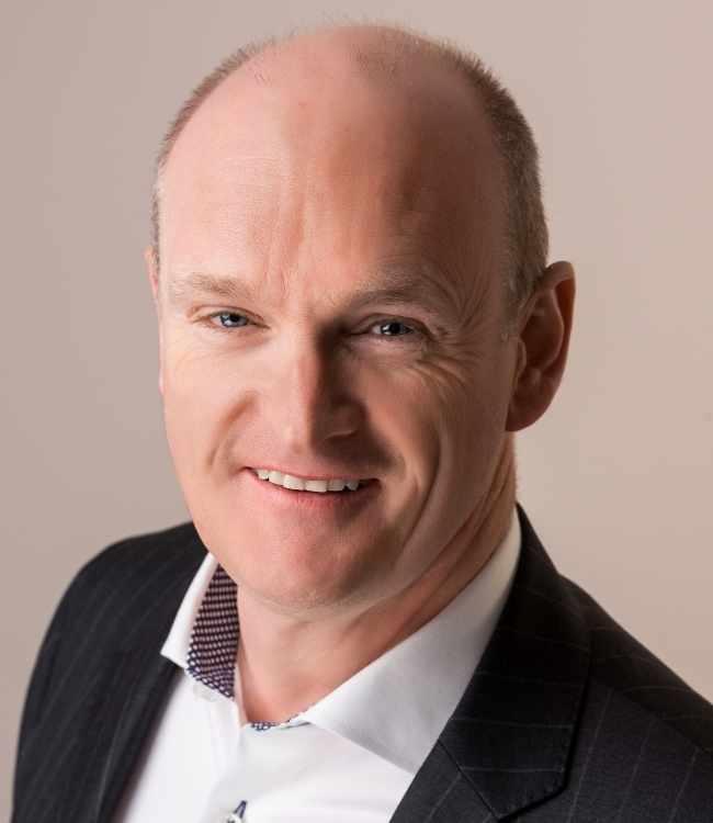 a headshot of Sean Weafer
