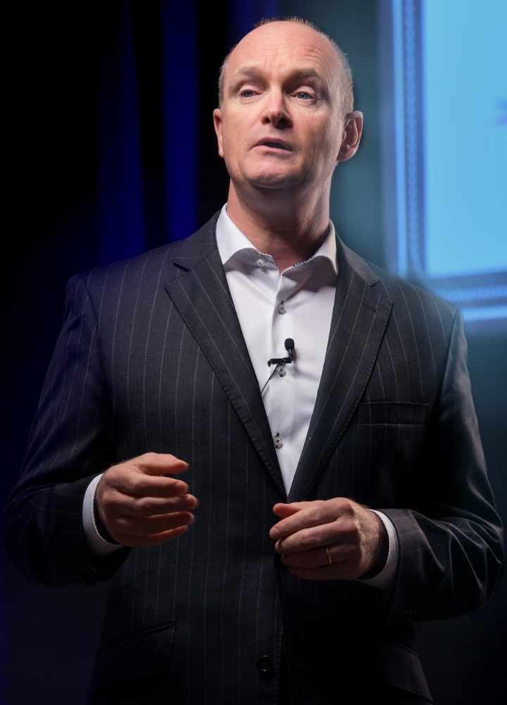 Sean Weafer delivering a Keynote presentation on stage