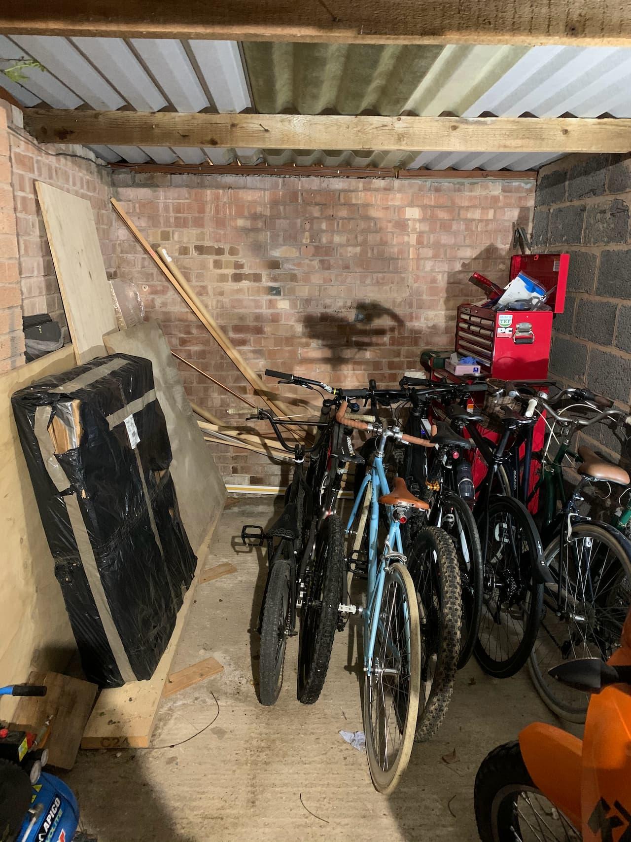 An untidy garage full of bikes