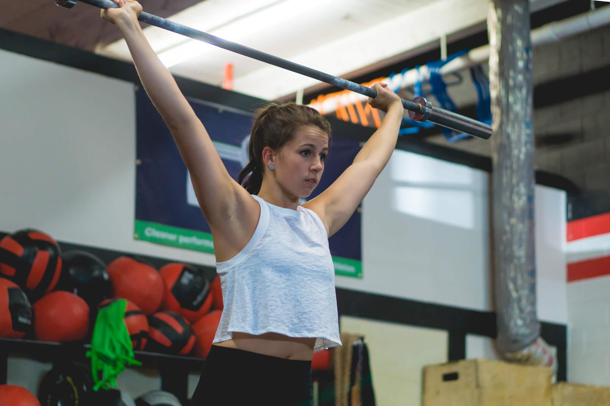 Girl weightlifting while avoiding injury