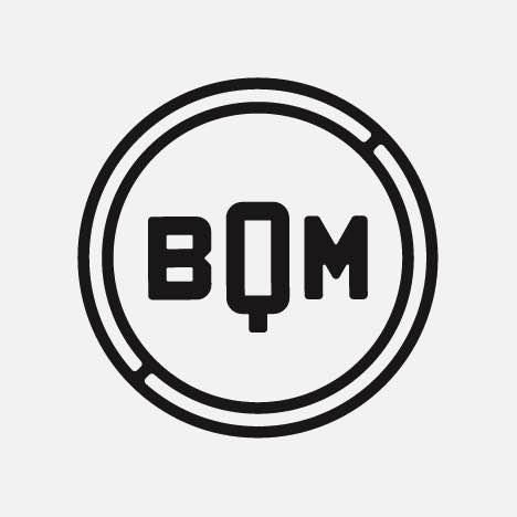 A small round monogram logo
