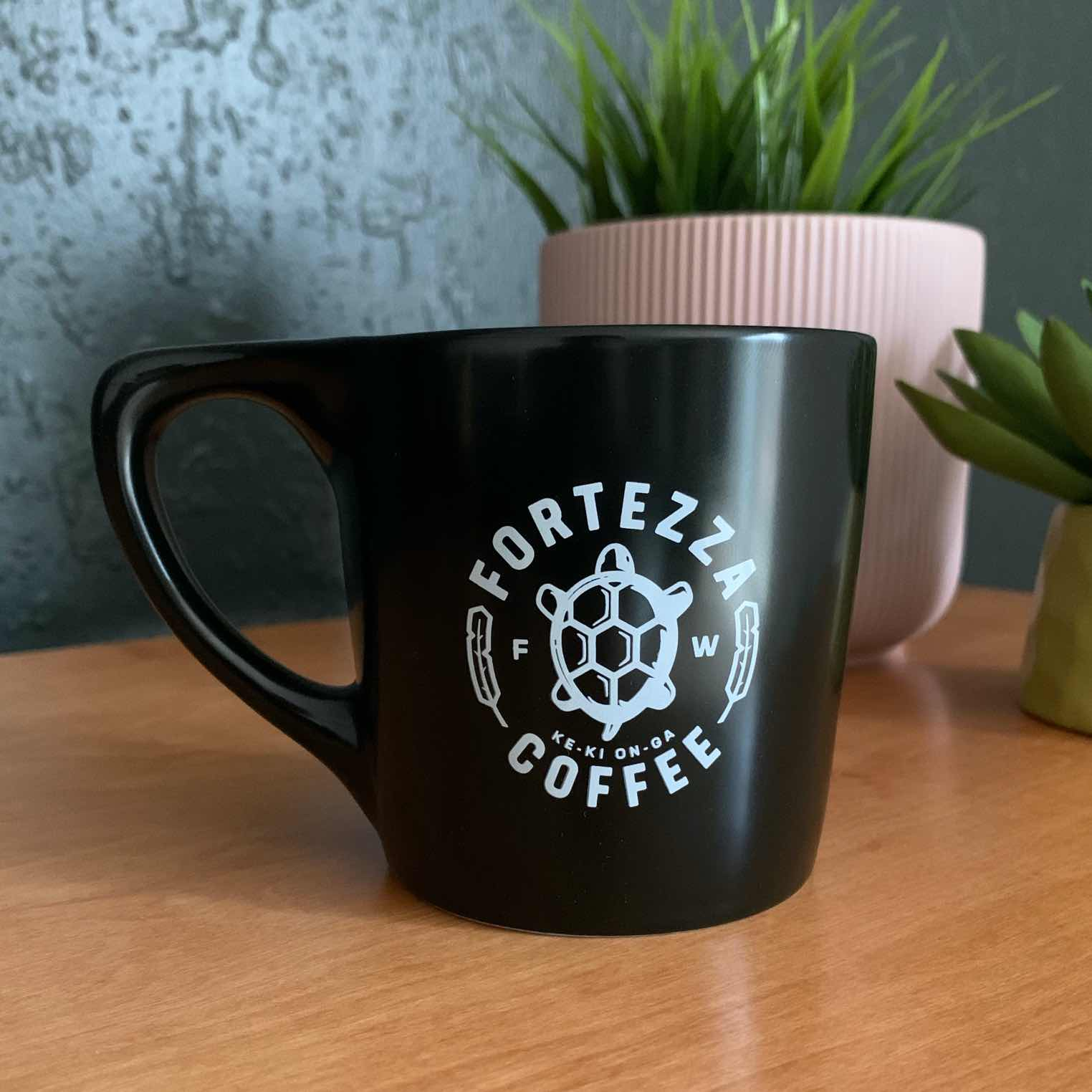 Black coffee mug with logo