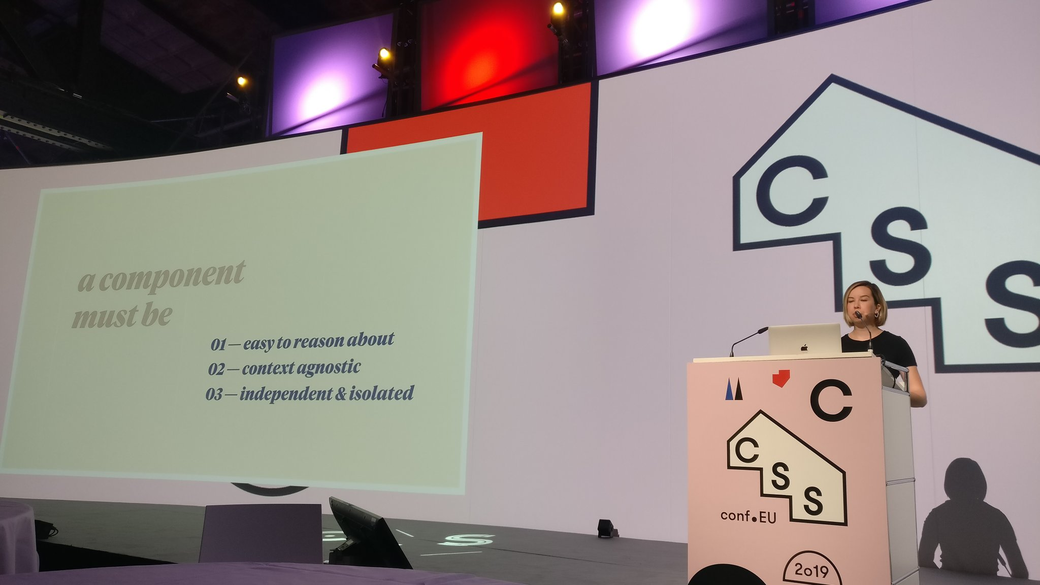 Elyse on stage giving a conference talk at CSSConf EU Berlin