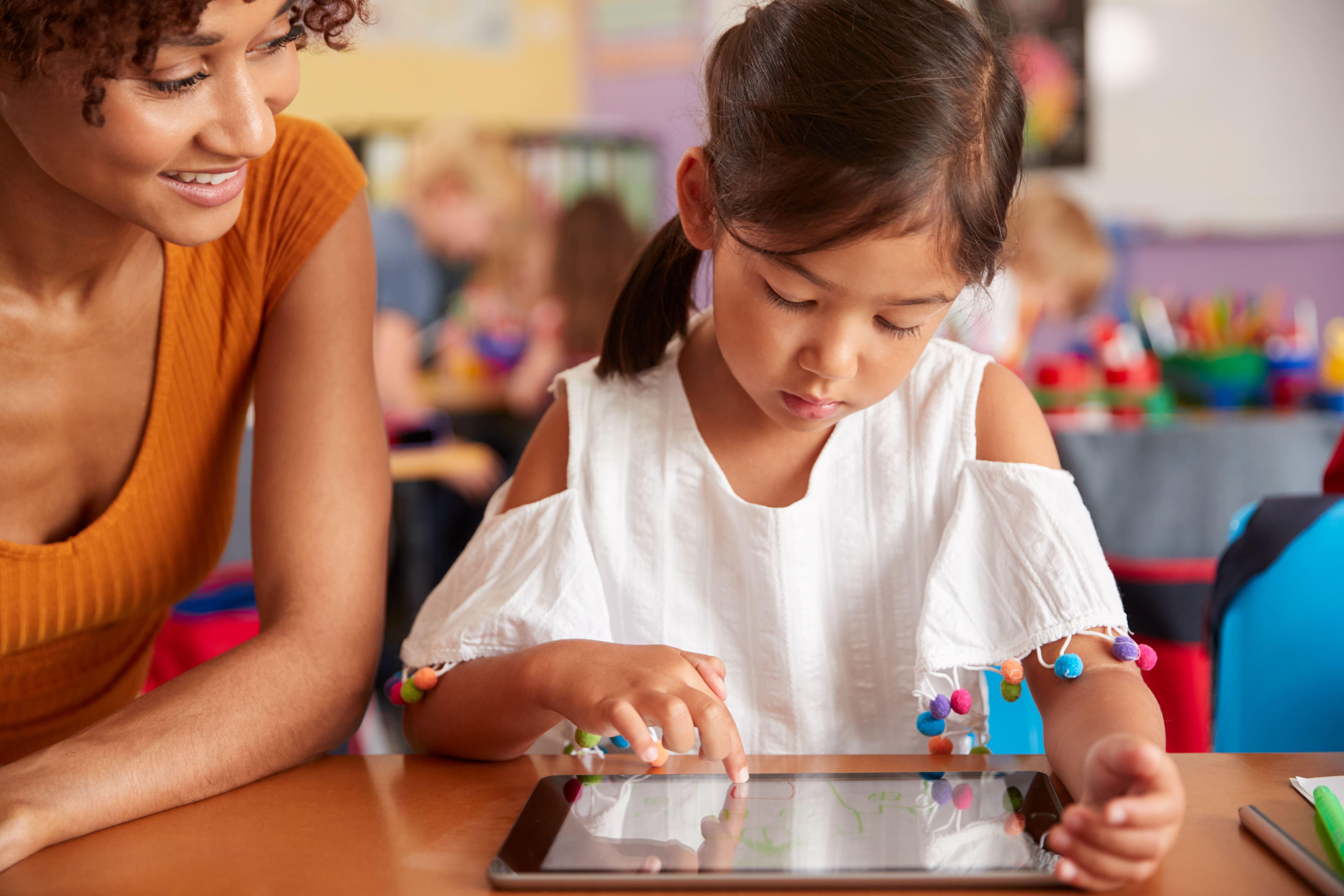 Teacher reading reports on iPad from Boddle Teacher Platform