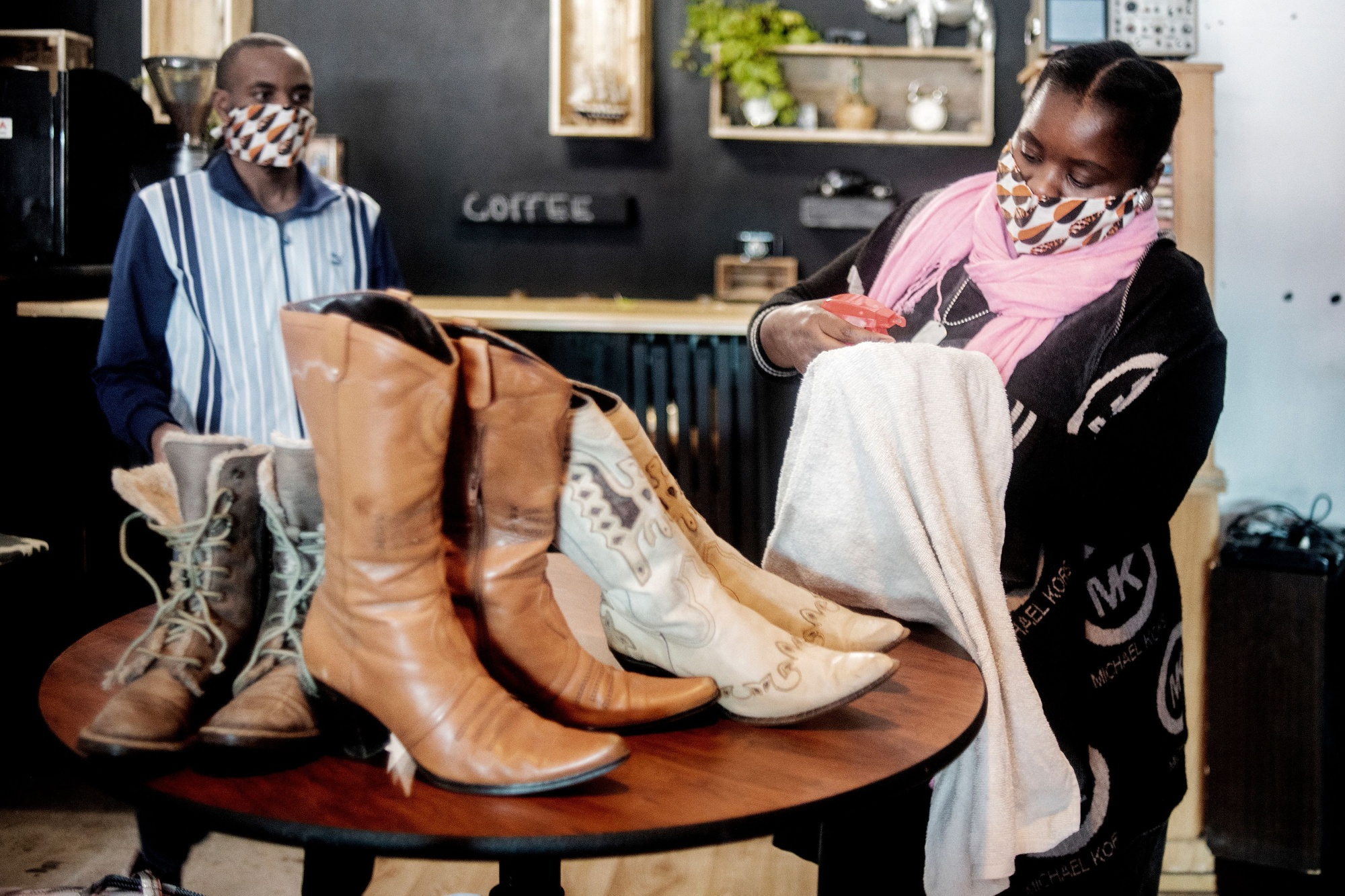 Workers of a shop prepare to reopen in Melville, Johannesburg.