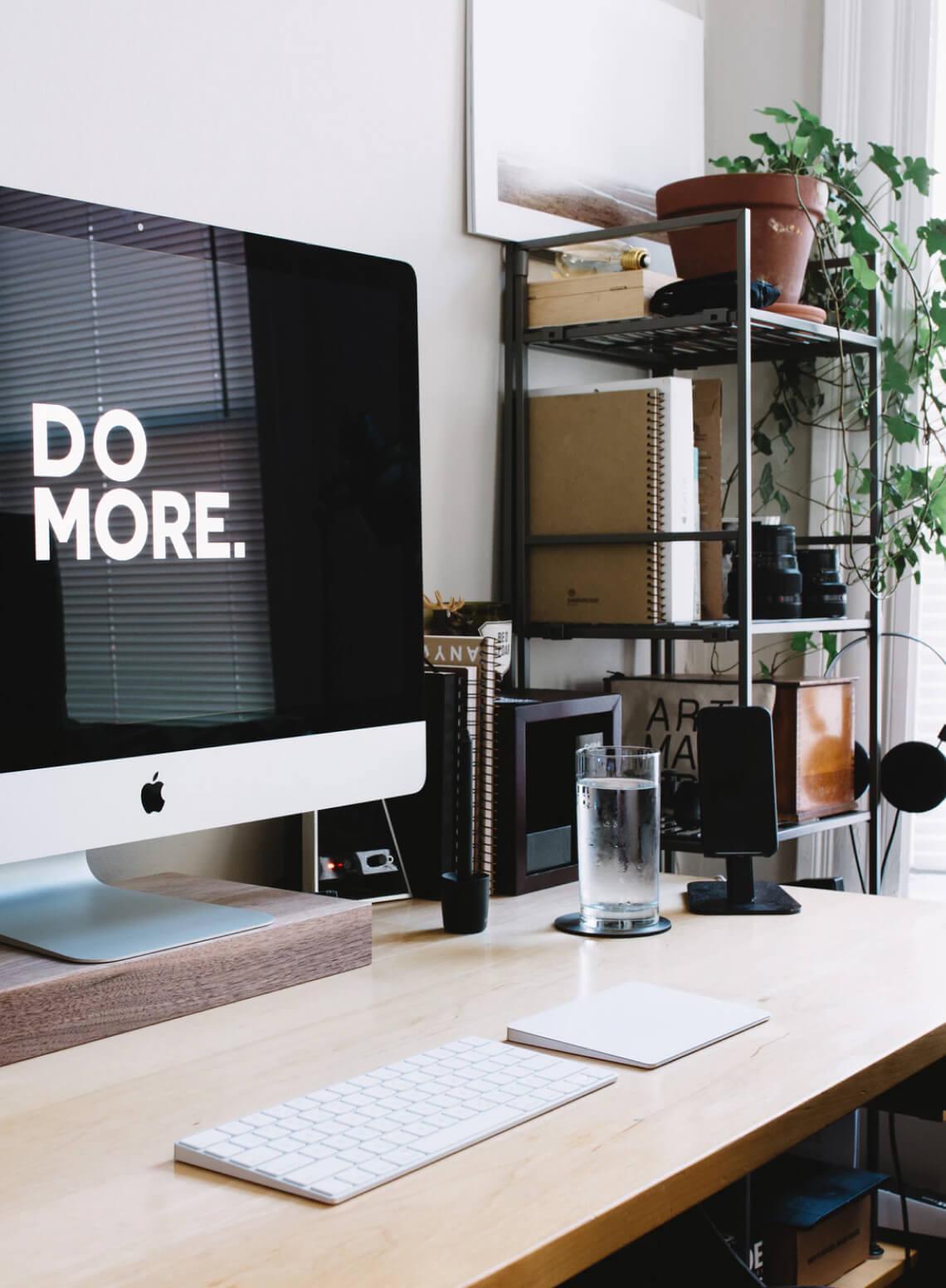 A desk setup with an iMac