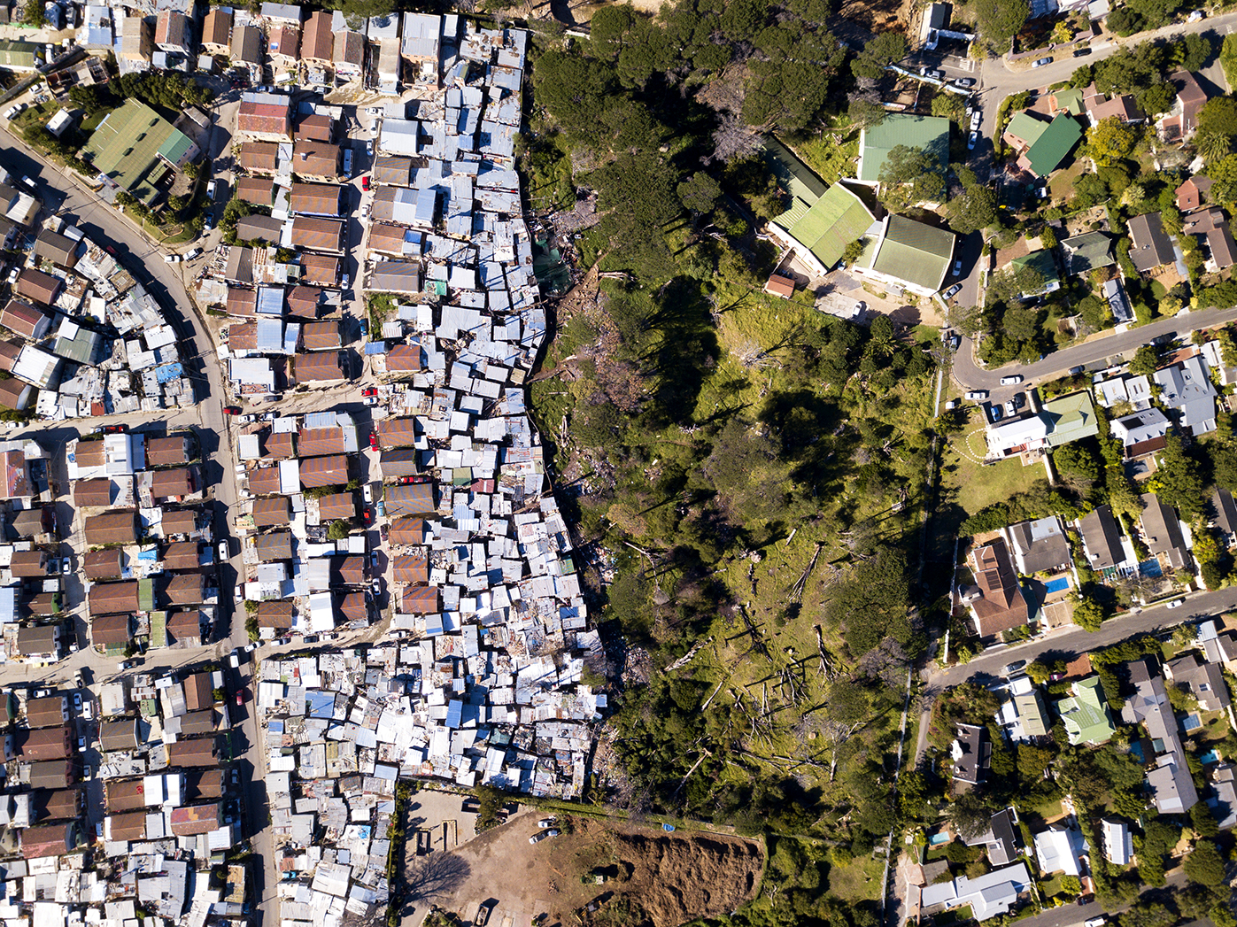 Aerial picture showing large houses next to township in Cape Town South Africa