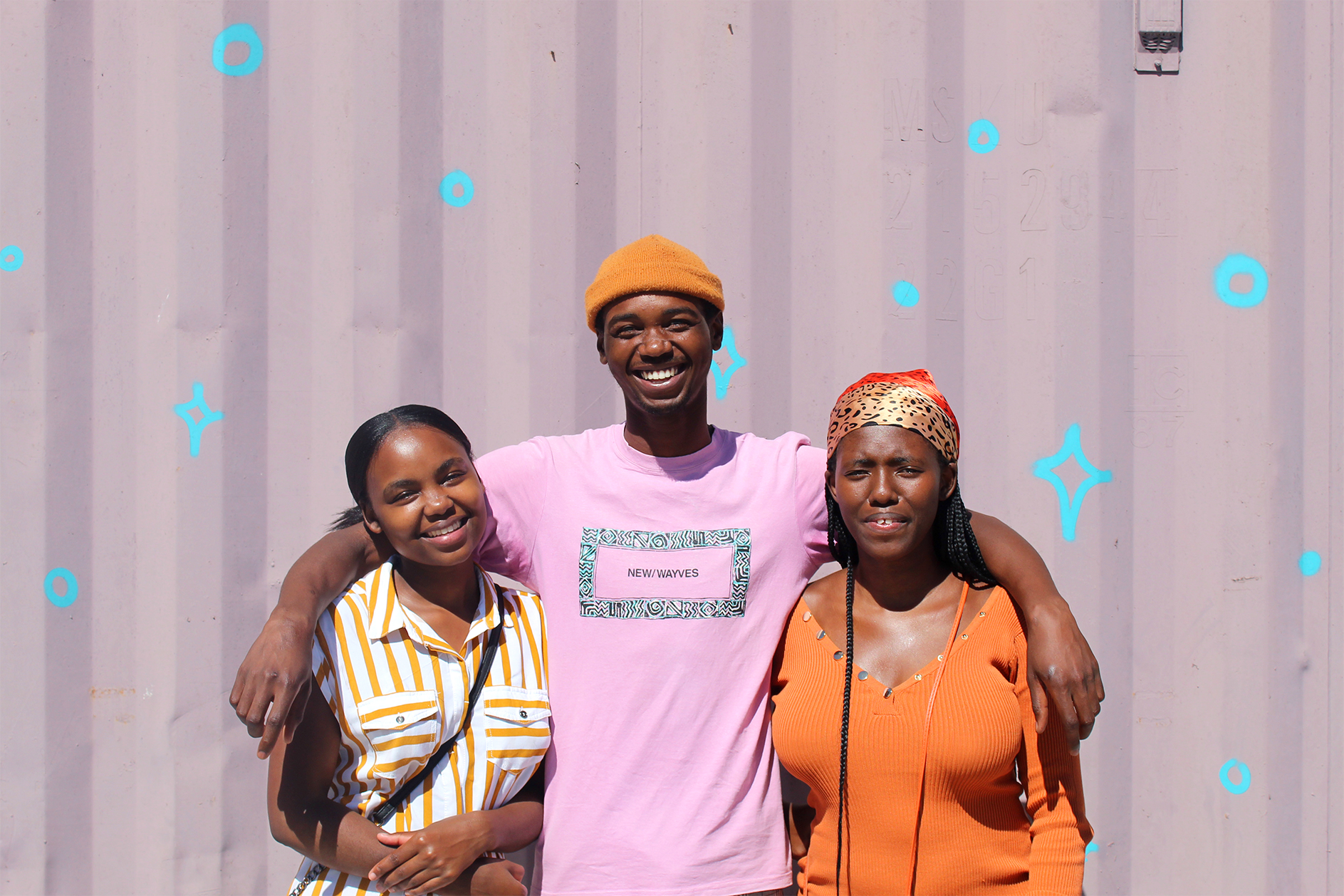 Three students holding each other in Cape Town South Africa