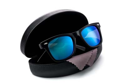 Product image of sunglasses presented in the case on the white background, Vivid Flow Studio