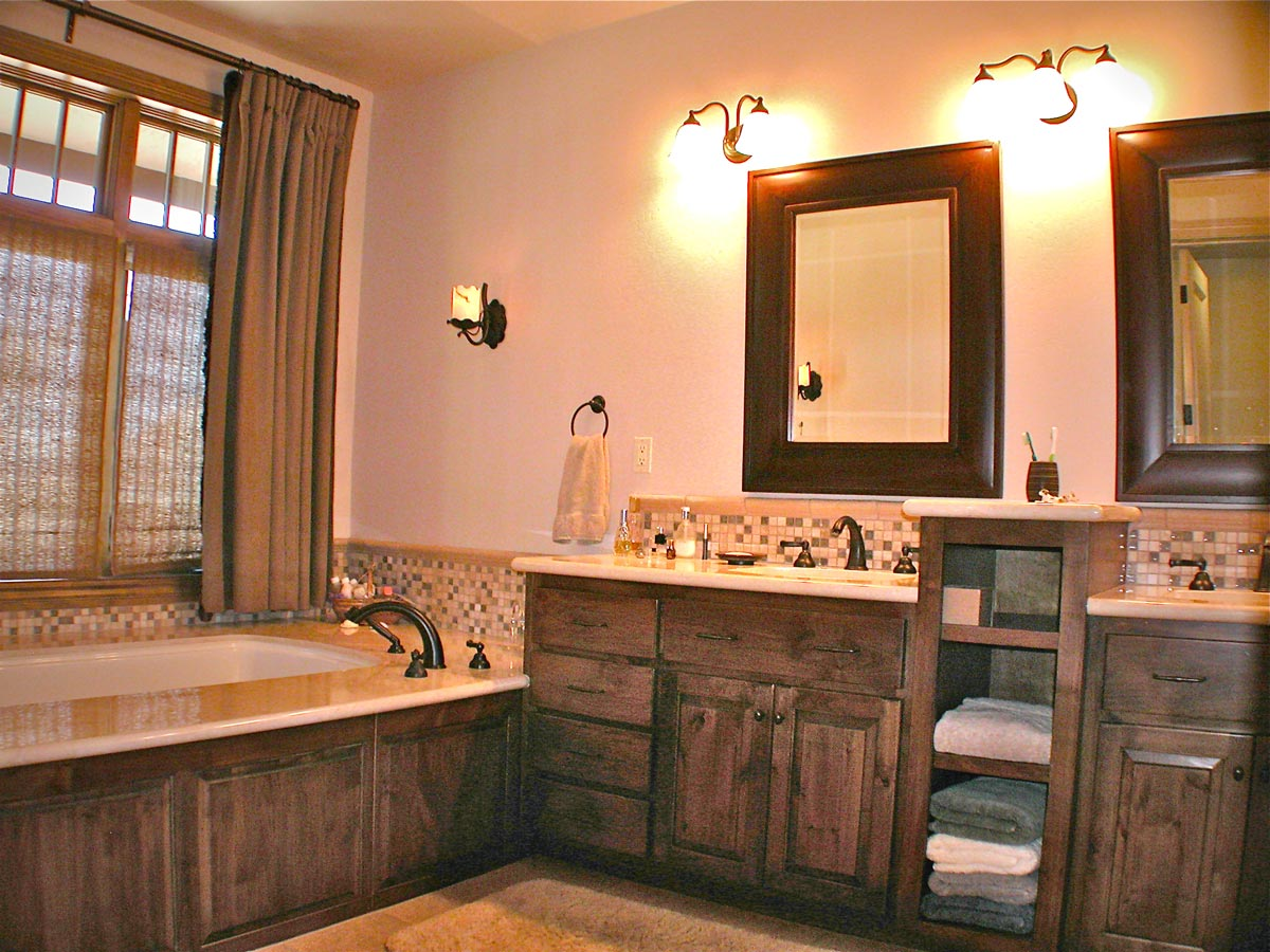 """The Master Bath features """"his and hers"""" sinks and counter space, luxurious tub and shower, as well as generous """"his and hers closets"""" with solar tube skylights."""