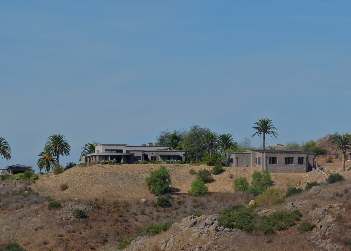 The house is nestled on the hillside above Highland Valley.