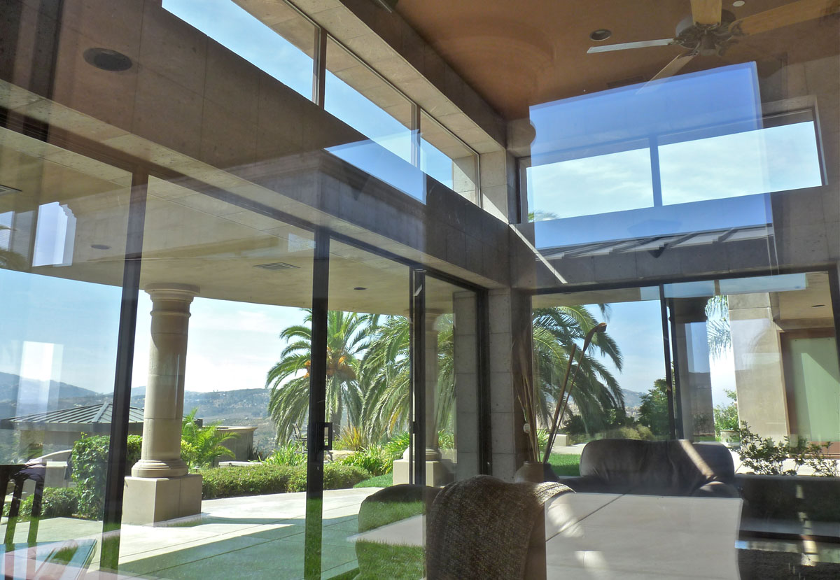 The great room at the center of the home features glass walls that slide back to open up the view.