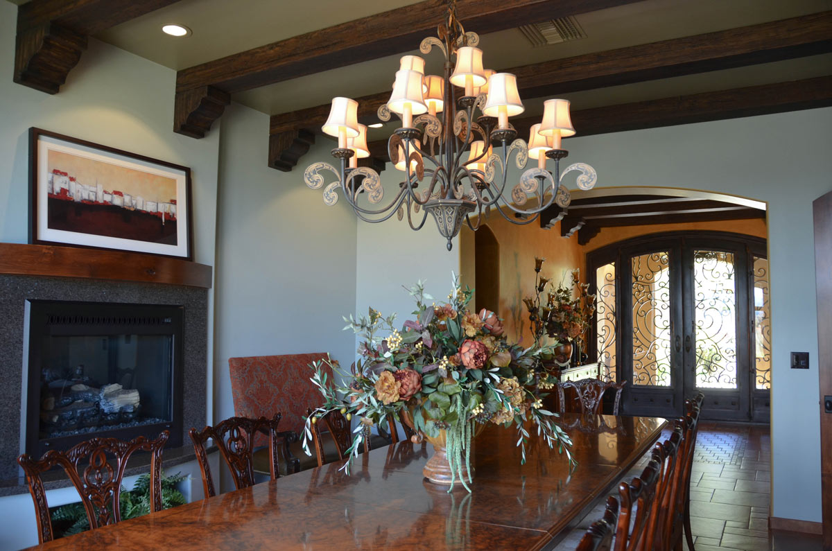 The Dining Room has a two sided fireplace shared with the adjacent home office.