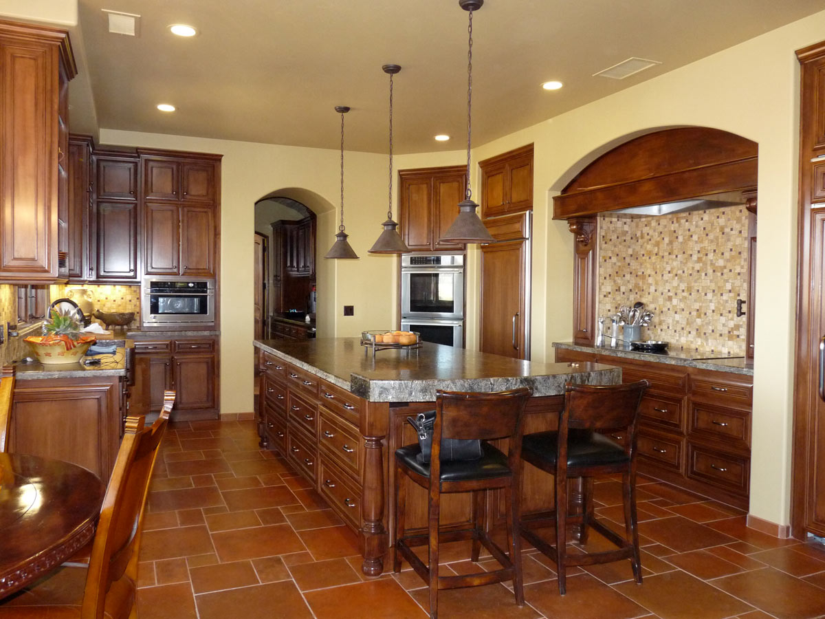 The spacious Kitchen has a large center island, built in Sub Zero refrigerator and freezer with a beautiful view from the sink area.