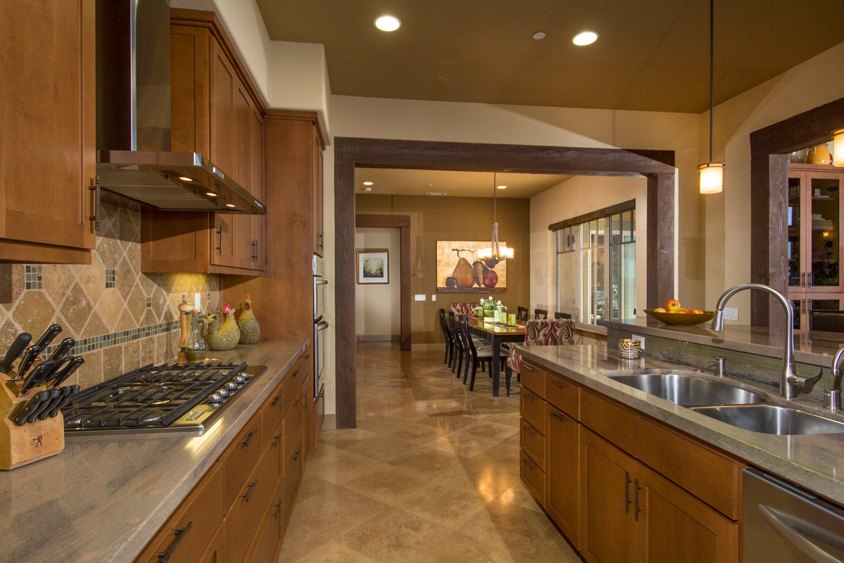 The kitchen has all built in appliances with a bar for additional seating and an adjacent home office.The kitchen has all built in appliances with a bar for additional seating and an adjacent home office.