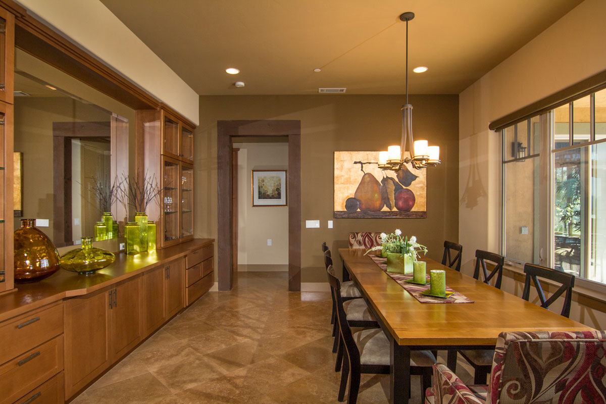 The opposite wall of the Dining Room has custom built-in cabinetry and a large mirror which reflects the view for all to enjoy, no matter which direction the guest is facing.