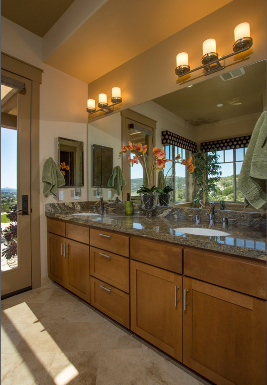 The Master Bath has granite countertops, a free standing tub and an open shower with a therapeutic pebble floor.