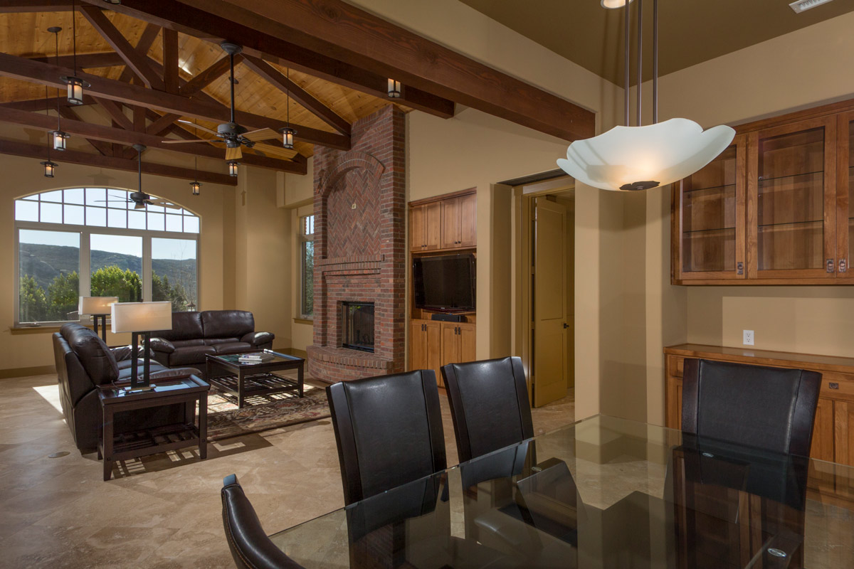 The Dining area is open to the Great Room with a view of the brick fireplace and centralized built-in entertainment center for stereo and flat screen t.v.