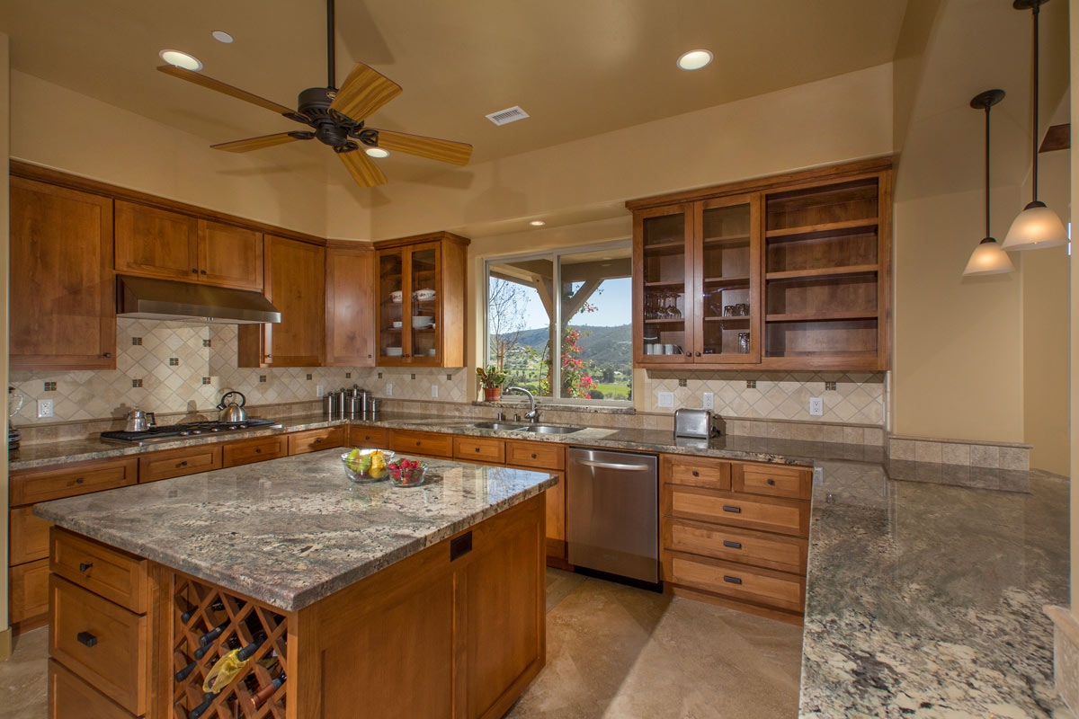 The Kitchen has all built in appliances, granite countertops, full height tile backsplash and a large island with wine storage. The window at the sink takes advantage of the beautiful view of the mountains to the east.