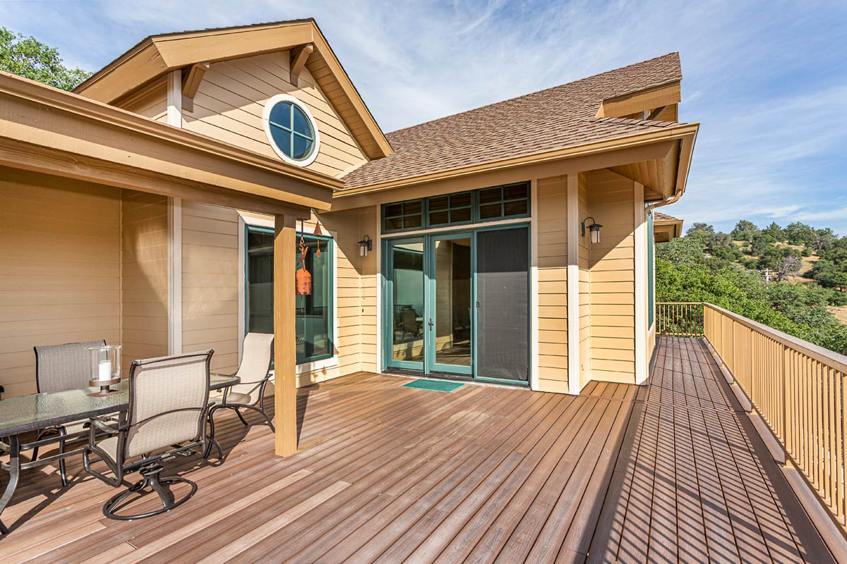 The house has extensive decks that look out to the beautiful surrounding mountains and valleys.