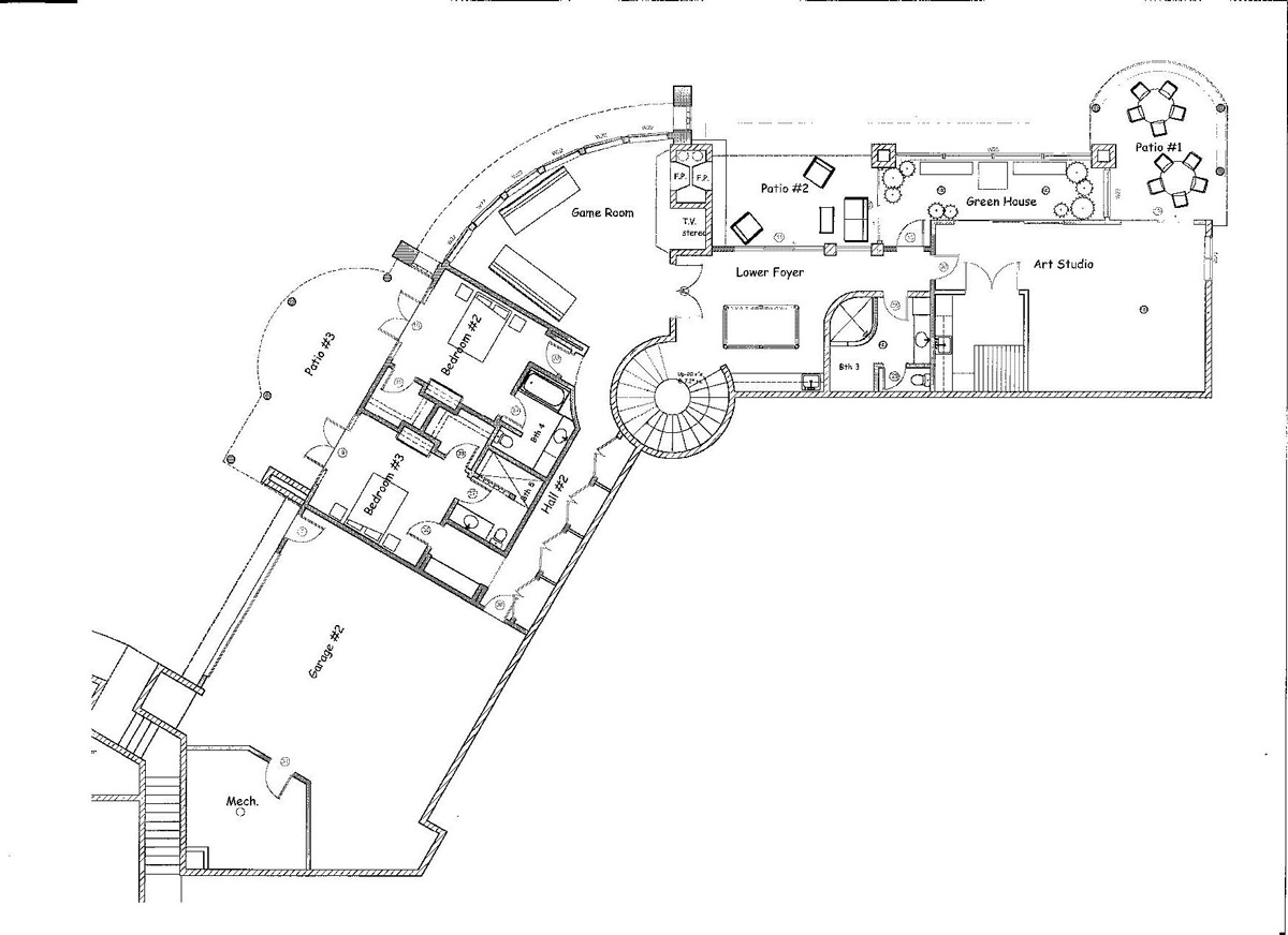 The lower level plan, includes two additional bedrooms, an entertainment bar, den, artist's studio and an addition three car garage directly above the other.