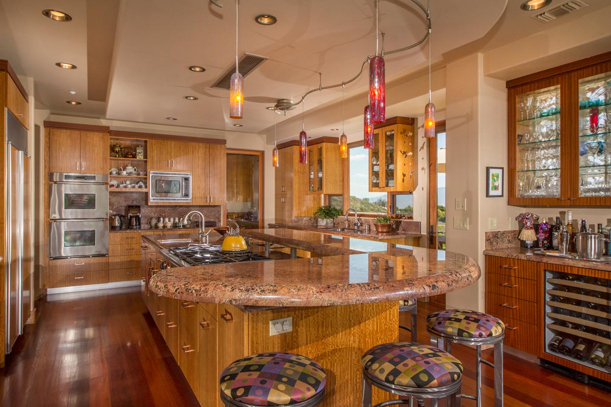 The Kitchen with sustainable, bamboo cabinetry, has a glass block window behind the cabinet with glass doors, to let in natural light.