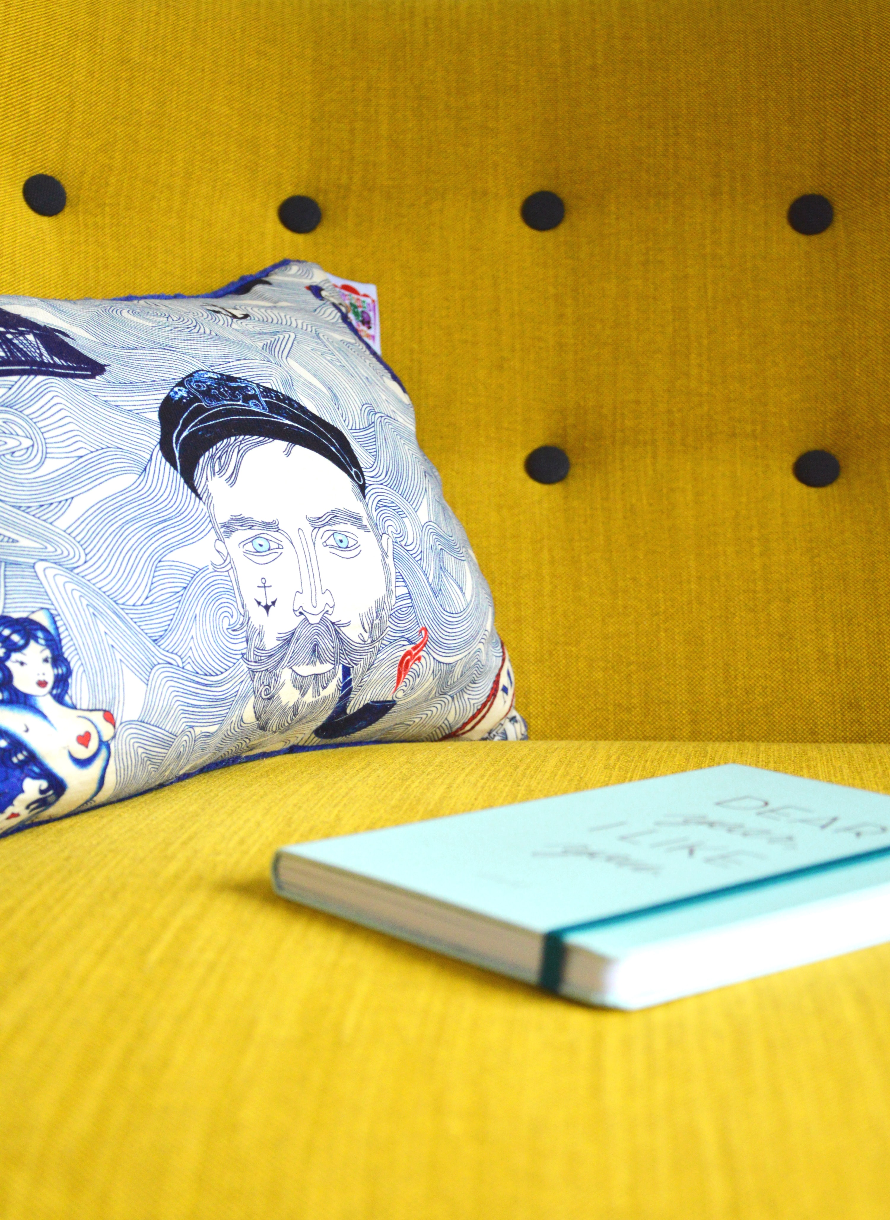 Book, cushion and a seat