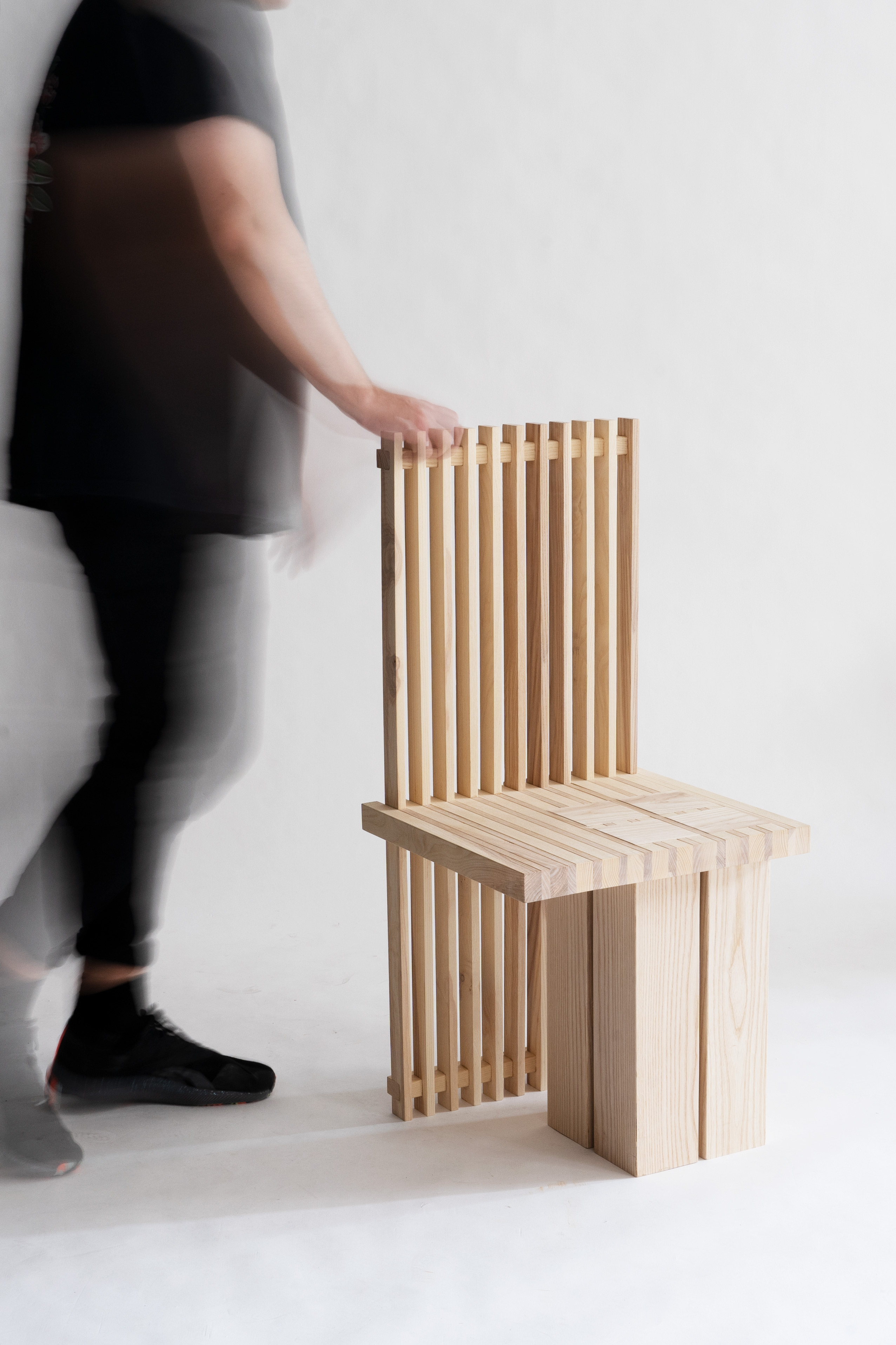 Side view of desk, chair, and lamp design, made of wood