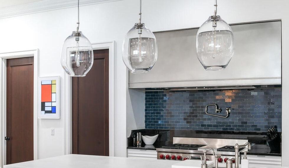 Modern Custom Range Hood made from Stainless Steel in a Minimalist Kitchen