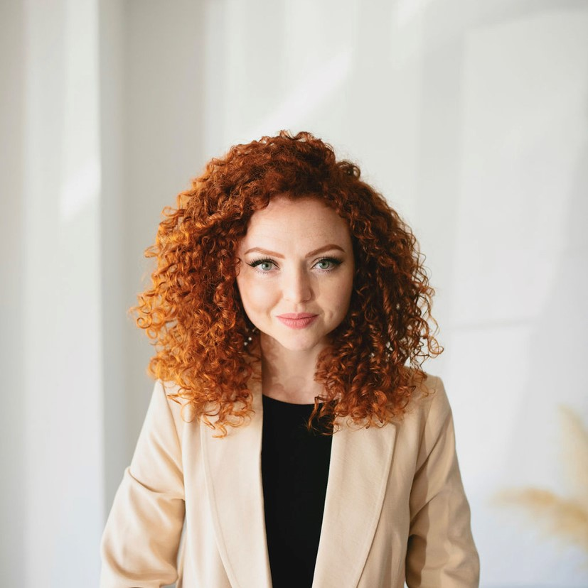 permanent makeup artist with red curly hair