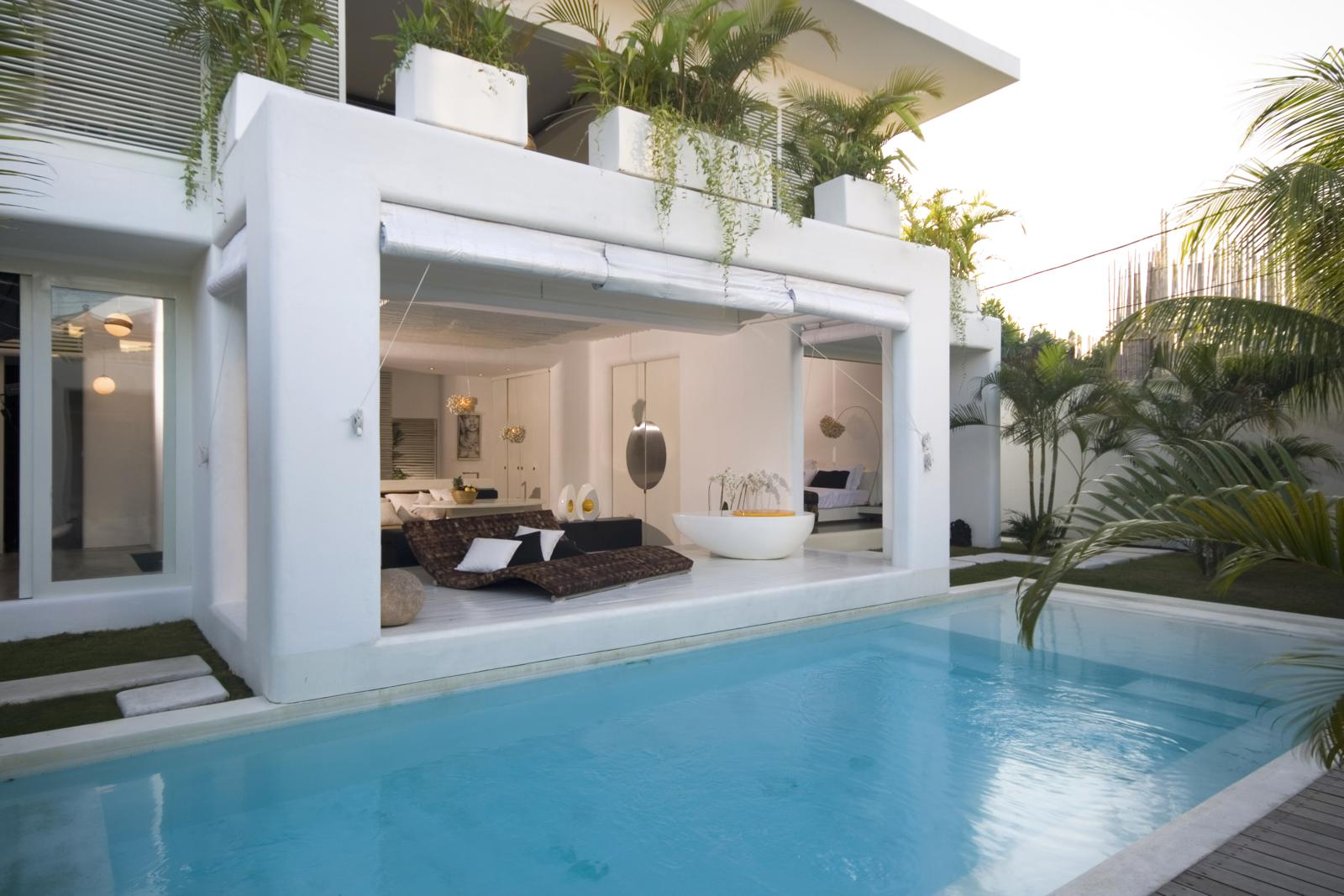 A house designed to entertain guests in the middle of urban Seminyak where interconnectedness of spaces has been the key to maximise the tight footprint.