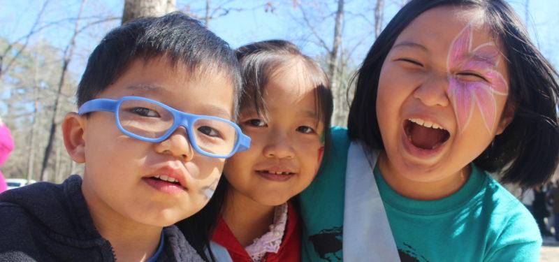 Decorative image: three kids laughing