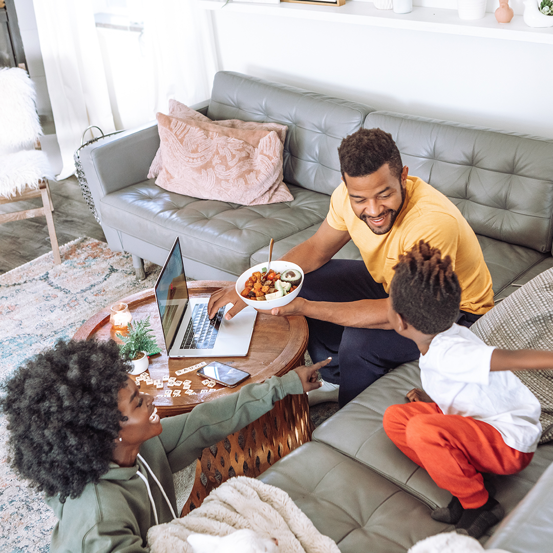 """Photo of family eating breakfast in living room. Photo by <a href=""""https://unsplash.com/@jimmydean?utm_source=unsplash&utm_medium=referral&utm_content=creditCopyText"""">Jimmy Dean</a> on <a href=""""/s/photos/family?utm_source=unsplash&utm_medium=referral&utm_content=creditCopyText"""">Unsplash</a>"""