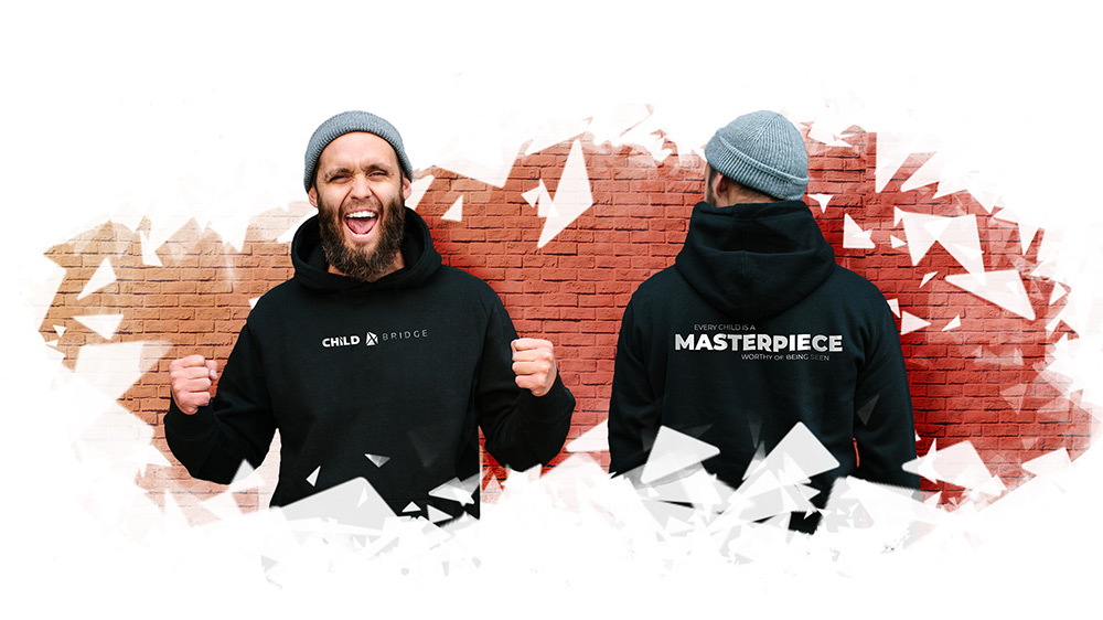 An excited bearded man wearing a Child Bridge hoodie.