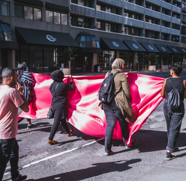 People carrying a banner