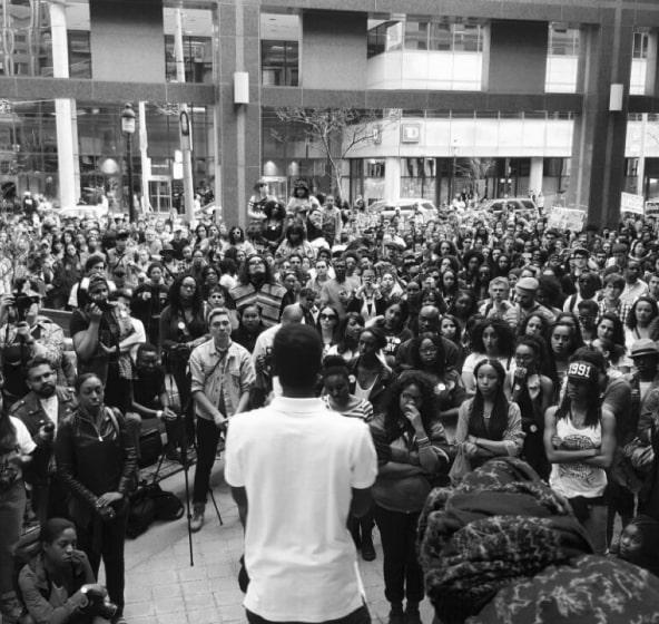 Crowd of people listening to a public speaker