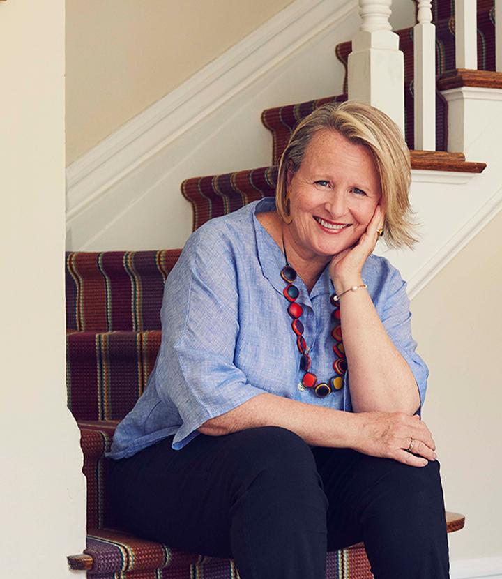 Ann sitting at home