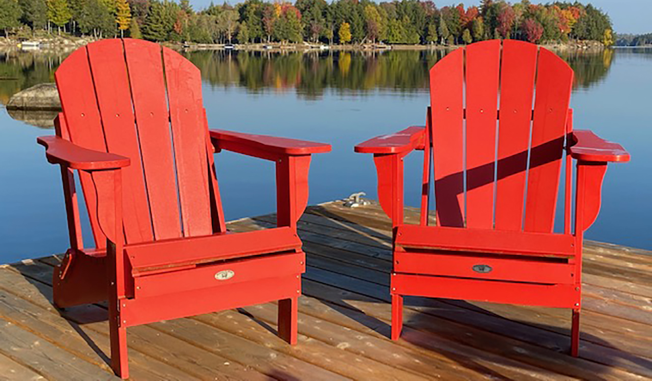 red chairs in front of lake