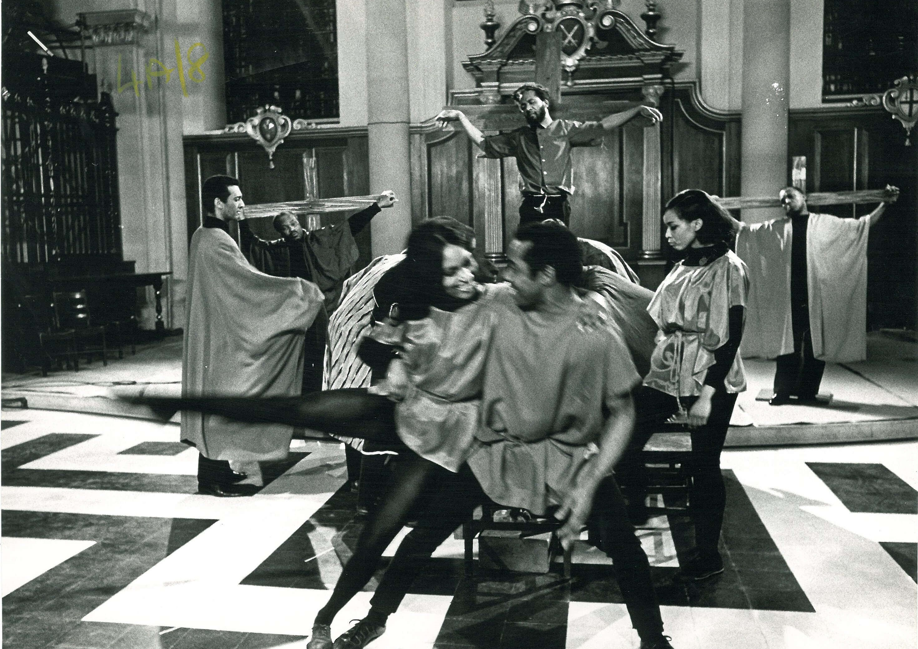 Photo (b/w) showing dancers in foreground, with George Browne on the Cross behind, flanked by two further crosses.